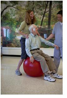 A elderly man participating in rehabilitation